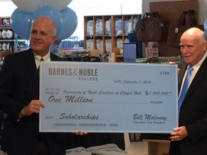 Barnes and Noble College presenting UNC with a $1 Million check as part of agreement to privatize Student Stores. Photo via Blake Hodge.