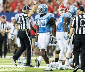 Sophomore middle linebacker Andre Smith (10) is similar to Trubisky in that they both are naturally a bit more quiet than some of their teammates. Their positions, however, require that they use their voice to deliver play calls and audibles. (Smith Cameron Photography)
