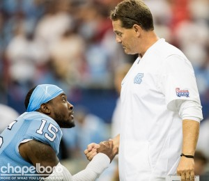 Defensive coordinator Gene Chizik shares a word with junior safety Donnie Miles. Miles took it upon himself this week to say he needs to do more to help keep the defense focused and on track. (Smith Cameron Photography)