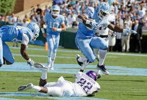Elijah Hood (34) complemented Trubisky's production with his first 100-yard game of the season on Saturday. (AP Photo/ Gerry Broome)