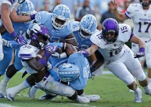 By the second half, running room was not as easy to find for James Madison--which was a result of UNC's mental adjustments. (AP Photo/ Gerry Broome)