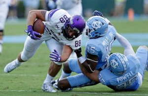 The James Madison ground attack worked wonders against the Tar Heels in the first quarter--building the visitors an early 21-14 advantage. (AP Photo/ Gerry Broome)