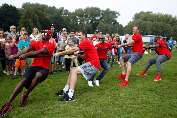 Tug of War with some fans at a community BBQ with the team