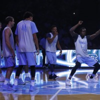 UNC junior forward/guard Theo Pinson (far right) is out indefinitely with a broken right foot. (Todd Melet)