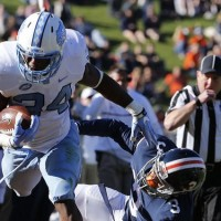 UNC junior tailback Elijah Hood tallied 107 yards on the ground, while also scoring the team's first touchdown against Virginia. (AP Photo/ Steve Helber)