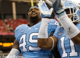 Clarke (left) picked up the fumble forced by Malik Carney late in Saturday's win over Miami--sealing the win for UNC in the process. (Smith Cameron Photography)