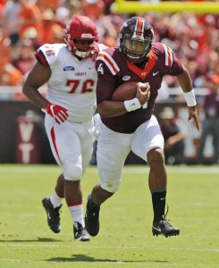 Virginia Tech quarterback Jerod Evans is a dual-threat player that reminds UNC head coach Larry Fedora of former Tar Heel starter Marquise Williams. (AP Photo/ Steve Helber)