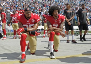 San Francisco 49ers safety Eric Reid (left) kneels during the National Anthem next to quarterback Colin Kaepernick (right). (AP Photo/ Mike McCarn)