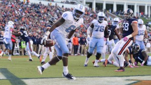 TJ Logan helped the Tar Heels begin to pull away from Virginia with touchdown run in the second half. (Jeffrey A. Camarati/ UNC Athletics)