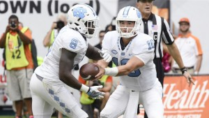 TJ Logan (left) and Mitch Trubisky (right) carried the UNC rushing attack against Miami, with Elijah Hood struggling in his first game back from a concussion. (Jeffrey A. Camarati/ UNC Athletics)