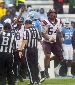 The Hokies celebrate after one of UNC's four turnovers during the game. (AP Photo/ Ben McKeown)