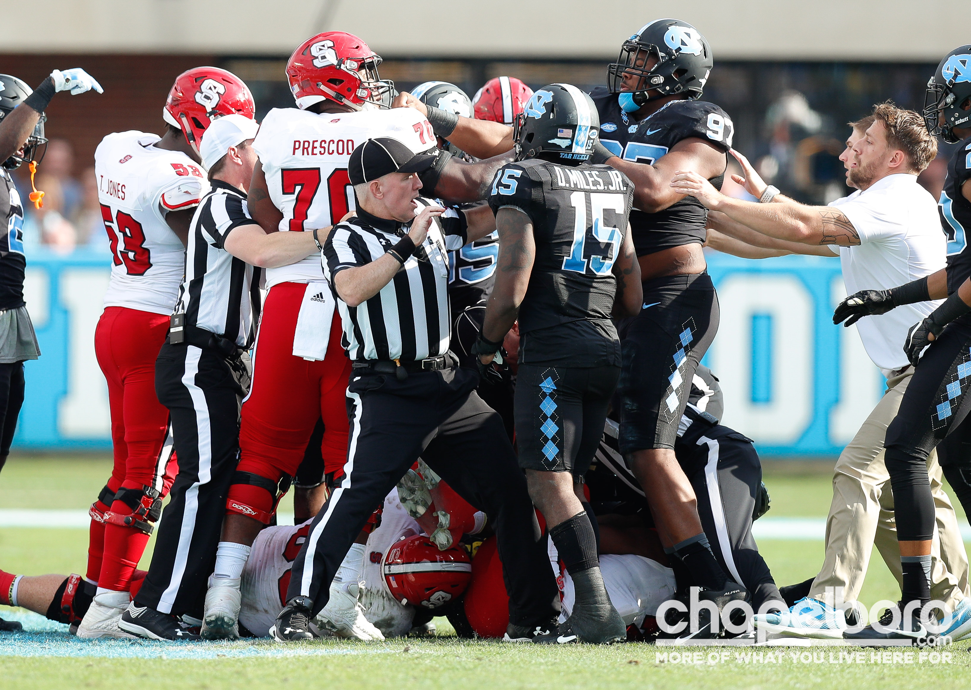 Referees had to separate a skirmish between NC State and UNC during the  second quarter. 2cf505917