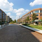 East West Partners Sells Environs at East 54 Housing Complex to Private Investor