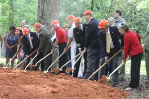 Members and supporters of the Orange County Veterans Memorial Committee break ground on Memorial Day. Photo by Bruce Rosenbloom/WCHL.