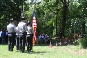 Sheriff's deputies prepare to post the colors during a groundbreaking ceremony held on Memorial Day. Photo by Bruce Rosenbloom/WCHL.